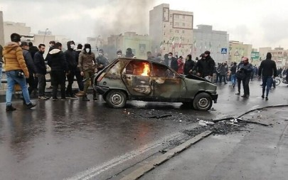 Iranian protesters gather around a burning car during a demonstration against an increase of gasoline prices, in the capital Tehran, November 16, 2019. (AFP)