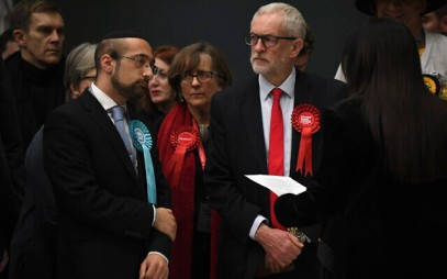 British opposition Labour Party leader Jeremy Corbyn, right, waits for the declaration of his seat in the 2019 general election in Islington, London, Dec. 13, 2019 (AP Photo/Alberto Pezzali)