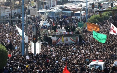 A large crowd surrounds the coffins of slain top commander Qasem Soleimani and Iraqi paramilitary chief Abu Mahdi al-Muhandis, as they are transported atop a vehicle after their arrival at Ahvaz International Airport in southwestern Iran on January 5, 2020. (FATEMEH RAHIMAVIAN / fars news / AFP)