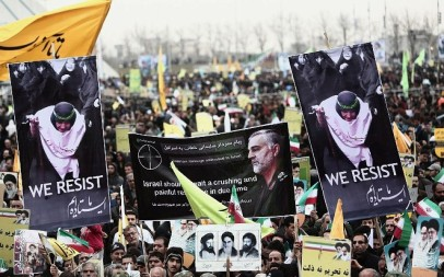 Iranian demonstrators hold a portrait of Maj. Gen. Qassem Soleimani, commander of the Quds Force in the Iranian Revolutionary Guards and a central figure in the violent spread of Iran's revolution. Photo taken in Tehran's Azadi Square, February 11, 2015. (Behrouz Mehri/AFP)