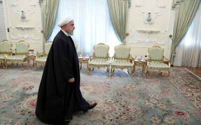 Iranian President Hassan Rouhani arrives for a meeting at the presidency office in Tehran, Iran, December 23, 2019. (Ebrahim Noroozi/AP)