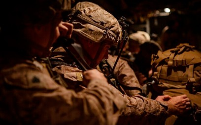 In this photo provided by US Department of Defense, US Marines assigned to Special Purpose Marine Air-Ground Task Force-Crisis Response-Central Command (SPMAGTF-CR-CC) 19.2, prepare to deploy from Kuwait in support of a crisis response mission, Tuesday, Dec. 31, 2019. (US Marine Corps photos by Sgt. Robert G. Gavaldon via AP)