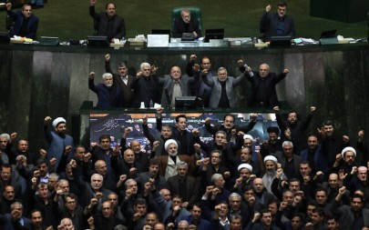 Iranian lawmakers chant anti-American and anti-Israeli slogans to protest against the US killing of Iranian general Qassem Soleimani, at the start of an open session of parliament in Tehran, Iran, Jan. 5, 2020. (Mohammad Hassanzadeh/Tasnim News Agency via AP)