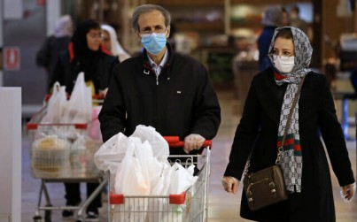 Shoppers wearing face masks and gloves shop at the Palladium Shopping Center, in northern Tehran, Iran, March 3, 2020. (AP Photo/Vahid Salemi)