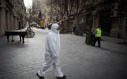 A man wearing protective clothes in downtown Jerusalem on March 20, 2020. (Nati Shohat/Flash90)