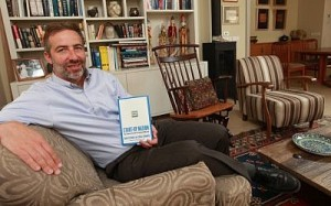"""Saul Singer with a copy of """"Start-Up Nation"""" (Photo credit: Nati Shohat/Flash90)"""