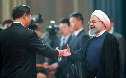 Chinese President Xi Jinping, left, greets Iranian President Hassan Rouhani at the Shanghai Cooperation Organization (SCO) Summit in Qingdao in eastern China's Shandong Province on June 10, 2018. (AP Photo/Alexander Zemlianichenko)