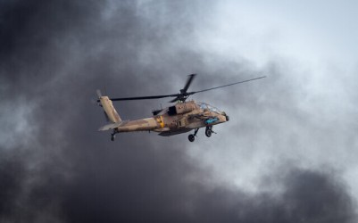 Illustrative: An Israeli Apache helicopter flies during an aerial show at a graduation ceremony for soldiers who have completed the IAF Flight Course, at the Hatzerim Air Base in the Negev desert, December 29, 2016.(Miriam Alster/Flash90)