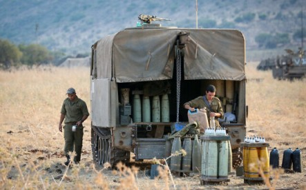 Israeli army forces seen stationed near the border between Israel and Lebanon in the Golan Heights on July 27, 2020. (David Cohen/Flash90)