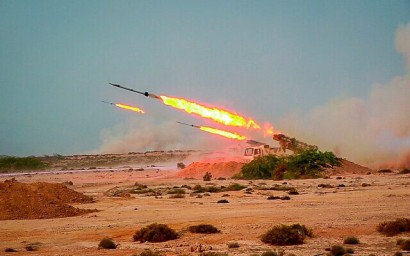 Missiles are fired in an Iranian military exercise by the Islamic Revolutionary Guards Corps, July 28, 2020,. (Sepahnews via AP)