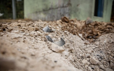 Remains of a rocket fired from the Gaza Strip near houses on a kibbutz in southern Israel on April 24, 2021 (Flash90)