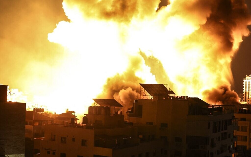 A ball of fire explodes above buildings in Gaza City as Israel shells the Palestinian enclave, early on May 18, 2021, amid fighting between the Israel Defense Forces and Gaza-ruling Hamas terror group. (Mahmud Hams/AFP)