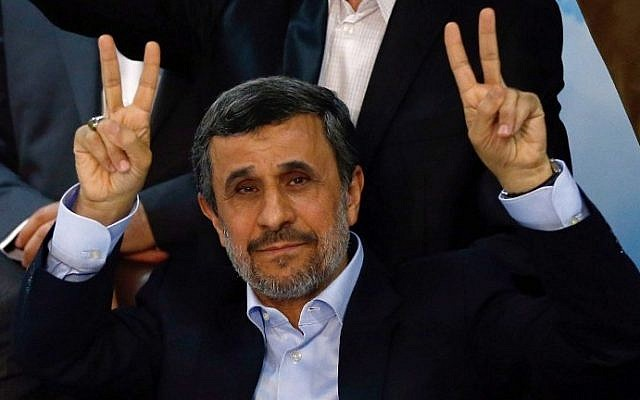 Former Iranian president Mahmoud Ahmadinejad (C) flashes the sign for victory at the interior ministry's election headquarters in Tehran on April 12, 2017. (AFP/Atta Kenare)