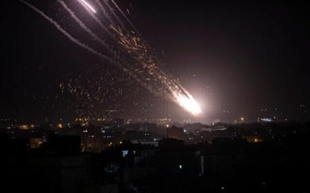 Rockets are launched from the Gaza Strip towards Israel, Monday, May. 10, 2021.  (AP Photo/Khalil Hamra)