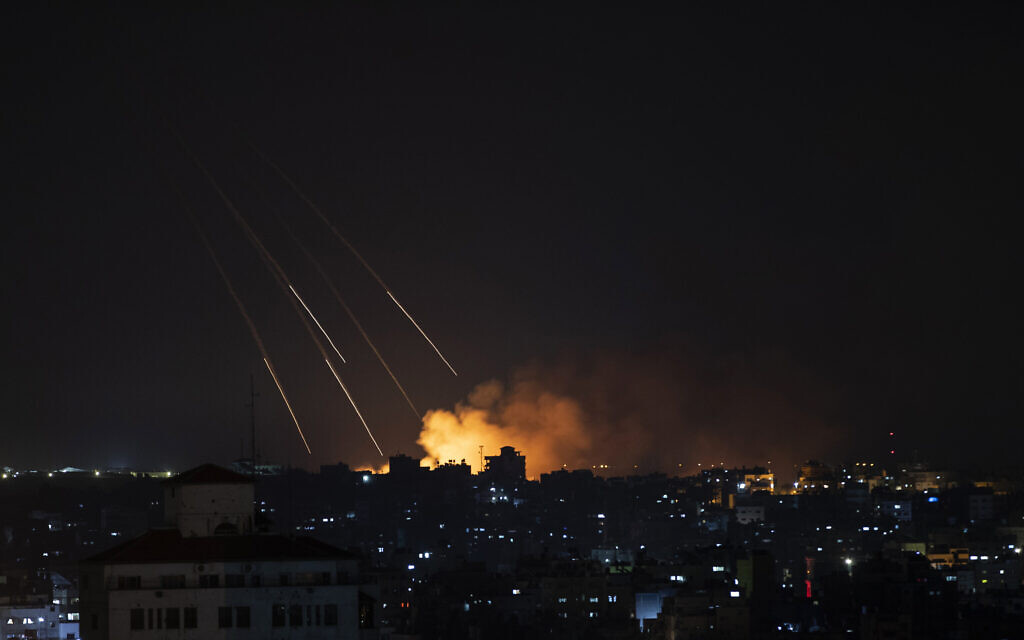 Smoke rises following Israeli missile strikes on Gaza City, Thursday, May 13, 2021. (AP Photo/Khalil Hamra)