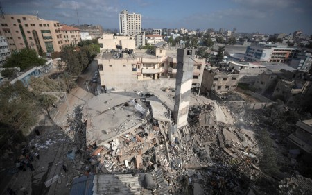 A top view shows the remains of a six-story building which was destroyed by an early morning Israeli airstrike, in Gaza City, May 18, 2021, amid fighting between the Israel Defense Forces and the coastal enclave's Hamas rulers. (AP Photo/Khalil Hamra)