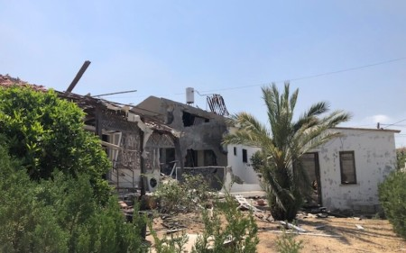 A home in Ashkelon damaged by rocket fire, which left a caregiver dead and an elderly woman badly injured, Tuesday May 12, 2021 (Lazar Berman. Times of Israel)