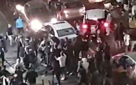 Screen capture from video of a crowd of Jewish protetors pulling an Arab man from his vehicle in Bet Yam, May 21, 2021. (Twitter)