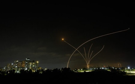 A long exposure picture shows Iron Dome anti-missile system fire as rockets are launched from the Gaza Strip, Ashkelon, May 10, 2021 (Edi Israel/Flash90)