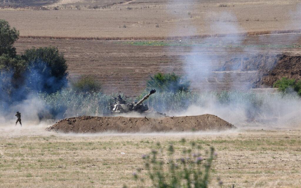 An Israel Defense Forces artillerypiece fires toward the Gaza Strip on May 18, 2021, amid fighting between the Israel Defense Forces and the coastal enclave's Hamas rulers. (Gili Yaari/Flash90)