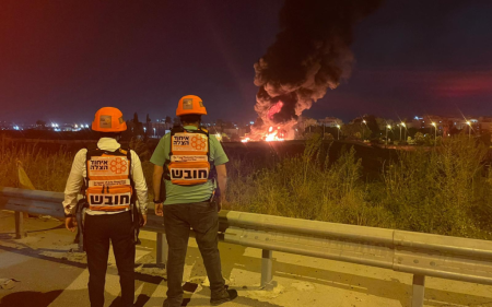 Paramedics observe a fire in Ramle, May 13, 2021. (United Hatzalah)